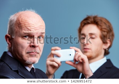 Senior businessman pulling a quizzical face Stock photo © Giulio_Fornasar