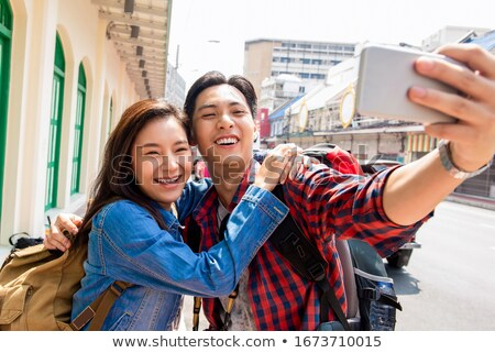 Stock photo: Attractive couple taking a selfie during asian vacation