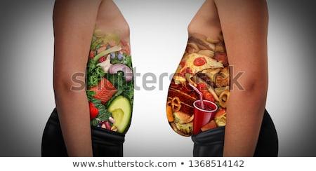 Obesidad hambre insalubre dieta grasa persona Foto stock © Lightsource