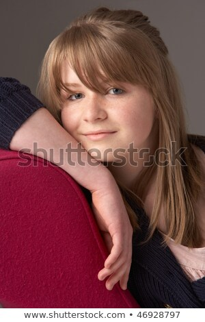 Thoughtful Teenage Girl Relaxing On Chaise Longue Stock photo © monkey_business