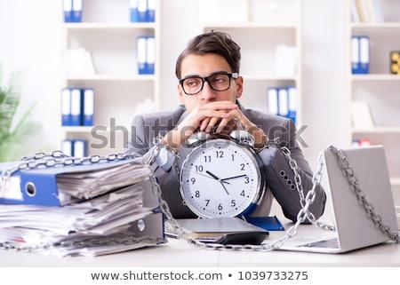 ストックフォト: The Busy Employee Chained To His Office Desk