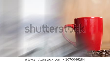Red coffee cup with beans and blurry window transition Stock photo © wavebreak_media
