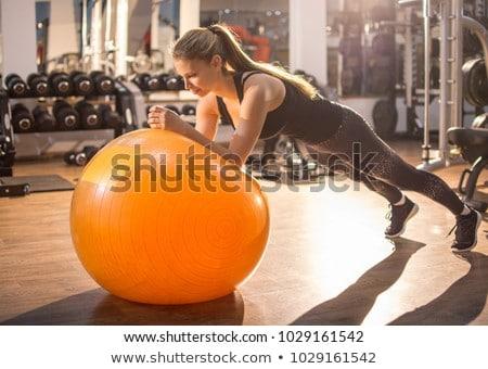 young women practicing pilates ball exercise stock photo © kzenon