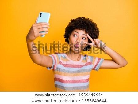 Lány küldés utazás fotó okostelefon mobil Stock fotó © tashatuvango