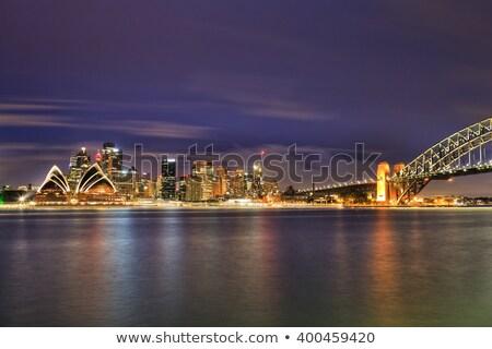 Sydney éjszaka körkörös kulcsok égbolt felhőkarcoló Stock fotó © epstock