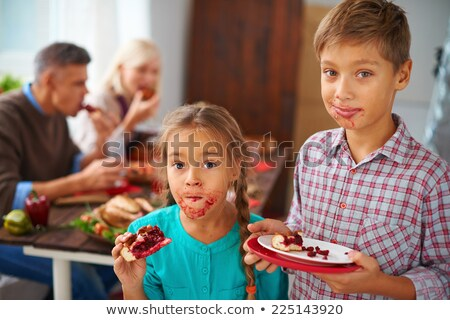Stock photo: children eating a pie