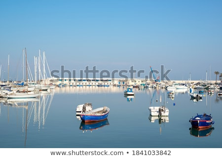 Sailboats and yachts in a quiet harbor ocean marina Stock photo © frank11
