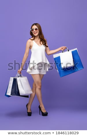 Full length portrait of shopaholic woman Stock photo © stockyimages