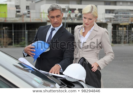 architect and assistant stood by car with plan stock photo © photography33