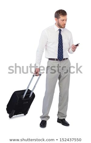 Przystojny mężczyzna patrząc w dół biały człowiek t-shirt mężczyzna Zdjęcia stock © wavebreak_media