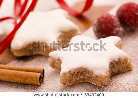 star shaped cinnamon biscuit, cinnamon sticks and hazelnuts Stock photo © Rob_Stark