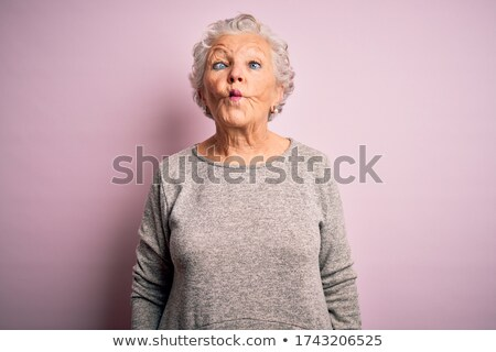Senior woman with pink hair and facial gesture Stock photo © zurijeta