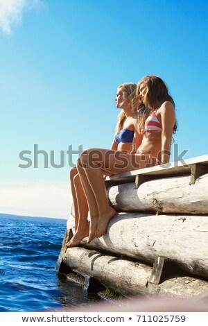 Nastolatki nogi molo piękna jezioro rzeki Zdjęcia stock © IS2