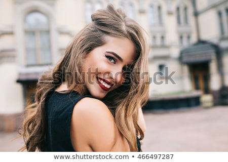 Portré gyönyörű fiatal nő visel fekete ruha áll Stock fotó © deandrobot