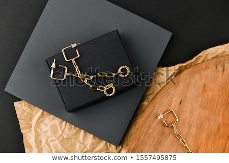 The beautiful woman in expensive pendant close-up Stock photo © serdechny