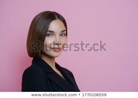 Sideways shot of beautiful Caucasian woman in elegant clothes, wears makeup, holds mobile phone, spe Stock photo © vkstudio