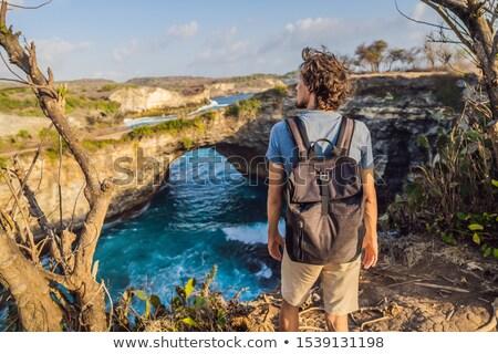 Young man tourist near Broken Beach in Nusa Penida, Indonesia Angel's BillaBong Beach. Popular touri Stock photo © galitskaya