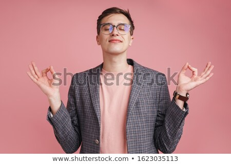Concentrated boy make meditate calm gesture. Stock photo © deandrobot