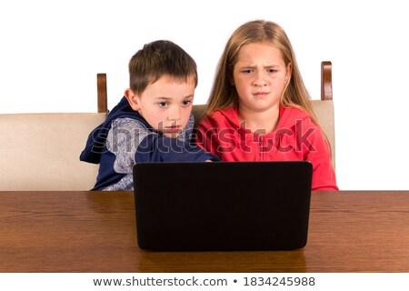 驚いた 少女 見える ノートパソコン 表情 孤立した ストックフォト © dacasdo