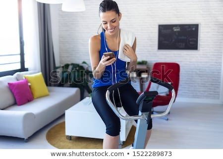 Woman using an exercise machine Stock photo © photography33