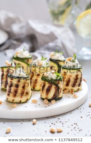 Stock photo: appetizer, grilled zucchini stuffed with cheese