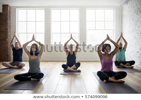 Kafkas yetişkin kadın yoga sınıf Stok fotoğraf © alexmillos