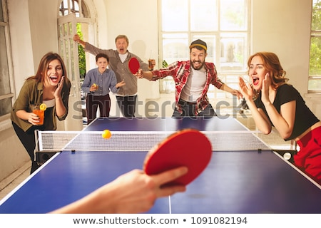 A Caucasian young man playing tabletennis Stock photo © bluering