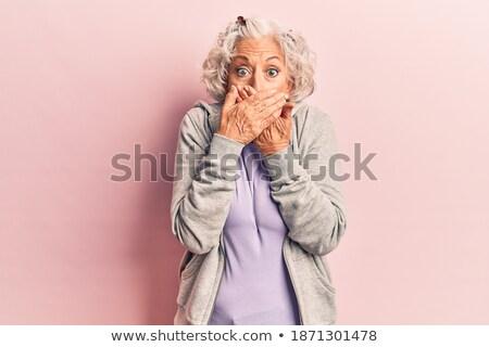 Portrait of senior astonished sporty woman Stock photo © boggy