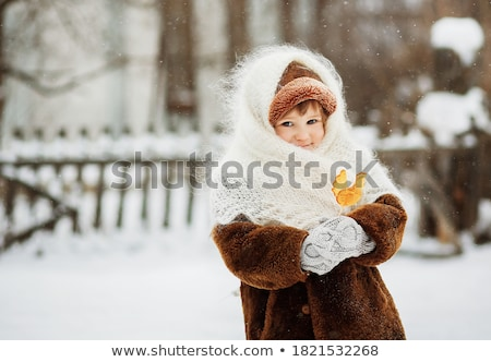 Child cute girl holding in the hands of lolipop on the street Stock photo © ElenaBatkova
