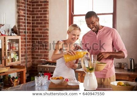 Koncentrált fiatal szerető pár konyha fotó Stock fotó © deandrobot