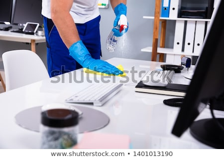 Male Janitor Cleaning Office Stock photo © AndreyPopov