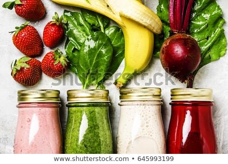 Cuatro vidrio botellas jugo de fruta supermercado caída Foto stock © photography33