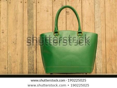 Purse On Wood Background Photo stock © caimacanul