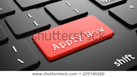 apply now on red keyboard button stock photo © tashatuvango