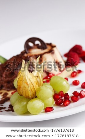 sweet dessert   chocolate and vanilla pudding with grapes and nu stock photo © yatsenko