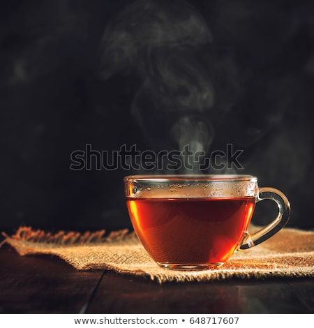 herbal tea in cup and kettle Stock photo © LightFieldStudios