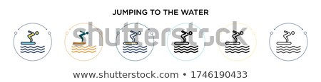 Man jumping into water on surfboard Stock photo © IS2