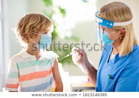 Gyerekek orvosi lány orvos óra gyermek Stock fotó © bluering