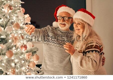 woman with an ornamented christmas ball Stock photo © nito