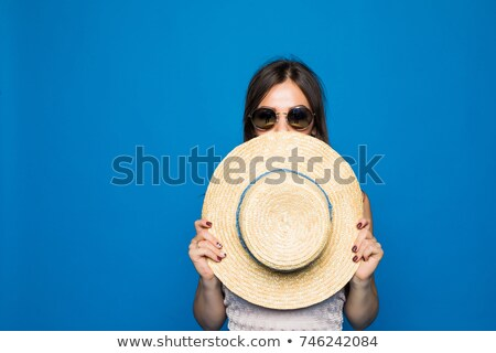 Attractive woman covered in white cloth on white Stock photo © artjazz