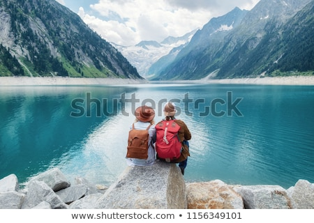 couple of travelers with backpacks hiking Stock photo © dolgachov