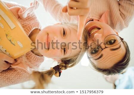 Stock fotó: Tanár · iskolás · lány · készít · vicces · arcok · mutat