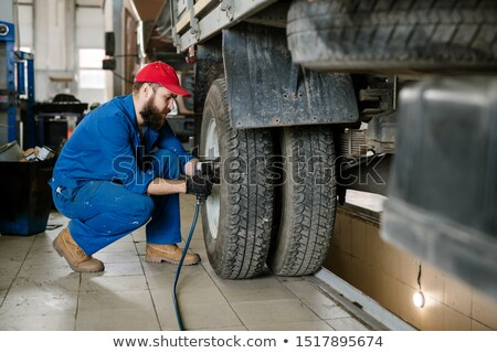 bearded worker of technical service using electric instrument during work stock photo © pressmaster