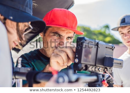 Man videographer shoots video in the electronic stabilizer, steadycam To shoot at Po Nagar Cham Tove Stock photo © galitskaya