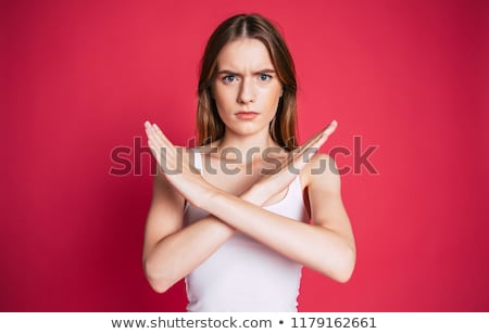 business woman with a sign of x Stock photo © Lopolo