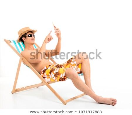 a man lying on a lounger stock photo © ruslanomega