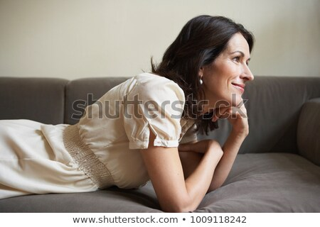 lying woman with brown hair side view stock photo © paha_l