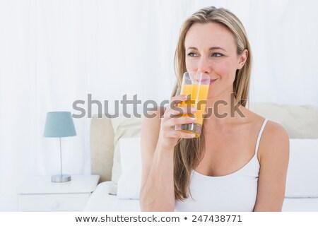 mulher · vidro · suco · de · laranja · polegar - foto stock © photography33