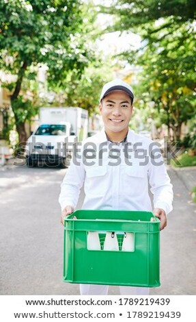 man holding crate of bottles to be recycled stock photo © photography33