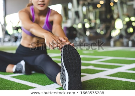 Diet and sport - young woman is doing sit-ups stock photo © Kzenon
